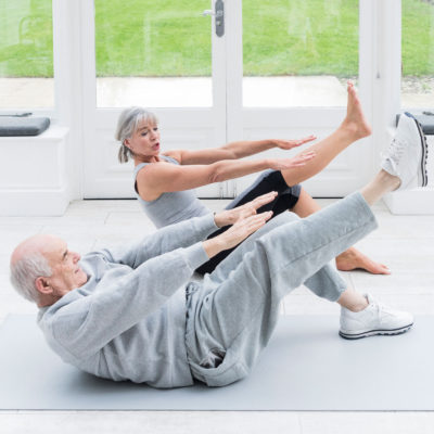 Two people exercising during a class.